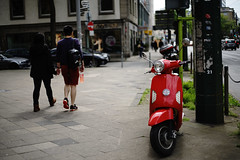 red@a corner of Düsseldorf (Amselchen) Tags: scooter street streetphotography pedestrians germany colour bokeh blur dof depthoffield sony a7rii alpha7rm2 sigma mc11 canon ef50mmf18ii sonyilce7rm2
