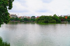 A view of the Hoan Kiem Lake, Hanoi, Vietnam (adamba100) Tags: asia asian china chinese korea korean mongolia mongolian vietnam vietnamese thai beijing town city view landscape cityscape street life lifestyle style people human person man men woman women male female girl boy child children kid interesting portrait innocent cute charm pretty beauty beautiful innocence play face headshot pure purity tourism sightseeing tourist travel trip light color colour outdoor traditional cambodia cambodian phnom penh sony a6300 18105 siem reap pattaya bangkok field gate architecture tree building
