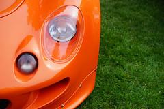 Lotus Motorsport Exige in detail (Eric Flexyourhead) Tags: vancouver canada britishcolumbia bc vandusenbotanicalgarden 2018 allbritishfieldmeet abfm car motor detail fragment british english lotus exige lotusexige lotusmotorsportexige s1 exiges1 headlight headlamp orange sonyalphaa7 zeisssonnartfe55mmf18za zeiss 55mmf18