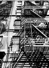 Greenwich Fire Escape (MassiveKontent) Tags: streetphotography bwphotography streetshot architecture geometric lines symmetry building bw contrast city monochrome urban blackandwhite streetphoto manhattan shadows nyc newyorkcity fireescape bricks