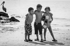 Down by the Sea, Chorillos (Geraint Rowland Photography) Tags: childphotography childportraits blackandwhite lima chorillos peru peruvianchildren wwwgeraintrowlandcouk travelblogginginlima visitlima beachesinlima lifeinperu geraintrowlandsocialphotographyinperu downbythesea beachlife pelicans nationalgeographic