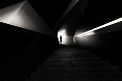The Photographer (fehlfarben_bine) Tags: nikond800 nikon160350mmf40 jewishmuseum daniellibeskind berlin architecture leadinglines stairs steps abstract space shadows blackwhite contrast availablelight streetphotography