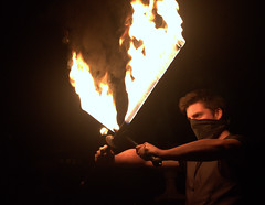 Fire swords (Tony Worrall) Tags: geometric abstract pattern texture symmetry color cool nice colours colourful fire show event preston sword burn fun night evening light alight shine burnings man candid burning flame flames flameon entertain performer