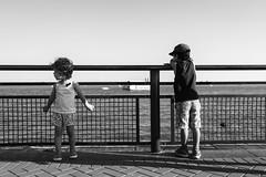Bored. (Livia Lopez) Tags: kids boardwalk sailboats water newyorkcity nyc manhattan newyork hudsonriver