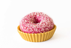 Brightly pink donut on a white background in a yellow ceramic holder (yannamelissa) Tags: donut pink isolated white background doughnut donuts frosted sprinkles frosting iced food closeup fresh bright sweet round delicious tasty snack breakfast sugar baked pastry unhealthy bakery fried glazed cake view top one dessert treat icing colorful strawberry edible calories sticky dough valentines day fat diet dish plate yellow ceramic