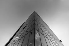 CLIFFHANGER (krisztian brego) Tags: sony a7 ii ilce7m2 voigtländer voigtlander ultra wideheliar 12mm f56 aspherical iii budapest duna tower office building architecture glass facade sky lines