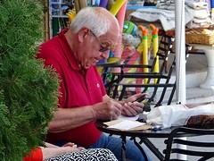Writing postcards - pleasure or work? (Ia Löfquist) Tags: crete kreta agiosnikolaos man writing skriver postvard vykort fs180429 arbete work fotosondag fotosöndag