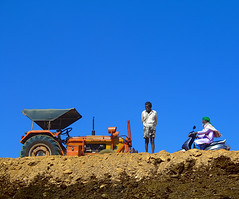 Earth Works (amuntu) Tags: ifttt 500px sports utility vehicle exploring truck pumpjack soil sunny blue sky india earthworks dirt tractor man earth