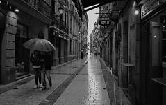 All it does is rain.... (Gabo Barreto) Tags: sansebastian donostia paisvasco basquecountry spain streetphotography street rain wet umbrella couple dark film analoguephotography monochrome blackandwhite c41 pointandshoot olympusstylusepic 35mm ilford xp2 scannedfromfilm