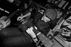 Benjamin Bassford. (Steve.T.) Tags: blackandwhite bnw blackandwhiteportrait benjaminbassford playingguitar guitarplayer guitar guitarist musician livegig livemusic panasonic dmctz40 soloartist blues theblues hat bluesmusician