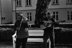 Street music! (Fredrik Blikeng) Tags: musicians stavanger guitar fiddle violin streetphotography urbanphotography monochrome blackandwhite canon ftb ql fd canonfd50mm kodak trix 400 tour people develop norway visitnorway jazz swing street music live concert livemusic