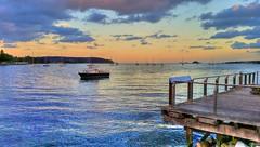 Sunset across the water ('phone camera photo) (elphweb) Tags: hdr highdynamicrange water ocean bay sea river sun sunset boat boats yackt yachts clouds sky evening sundown nsw australia skies