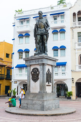 Statue of Pedro de Heredia, Cartagena, Colombia (MikePScott) Tags: arch architecturalfeatures balcony builtenvironment camera cartagena clouds colombia door featureslandmarks lens monument nikon2470mmf28 nikond600 palm sky statue trees window