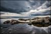 Ice and Rocks (Jonas Thomén) Tags: ice is rocks cliffs klippor stone sten stenar stones sea hav water vatten longexposure långexponering clouds moln evening kväll