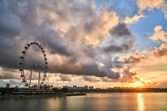 Sunrise, Singapore Flyer.... (yimING_) Tags: sunrise clouds reflection urban cityscape recreation singapore singaporeflyer ferriswheel tourism marina bay marinabarrage morning