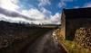 Tight squeeze (Phil-Gregory) Tags: nikon d7200 tokina1120mmatx tokina 1120mmproatx11 1120mm national naturalphotography naturephotography nationalpark lane barn cloud cloudscape colours countryside scenicsnotjustlandscapes landscapes wideangle