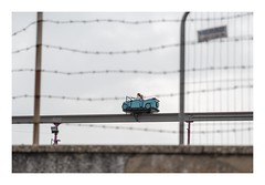 The Getaway (Number Johnny 5) Tags: tamron d750 nikon people wire theme mundane space beach imanoot candid fence johnpettigrew park 2470mm banal barbed pleasure monorail documenting barrier