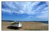 Sur la plage....abandonnée - On the beach .... abandoned (diaph76) Tags: extérieur france var provence paysage landscape ciel sky nuages clouds sable sand plage beach mer sea eaudemer seawater barque boat