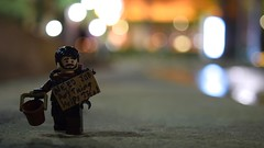Lookin' for change (RagingPhotography) Tags: lego homeless poor person sad poverty impoverish impoverished outside outdoor outdoors bright lights bokeh light shine shining dark shadow shadowy night plaza sign holding hold plastic toy toys minifigure minifig figure change look looking walk walking needy need worry worried ragingphotography