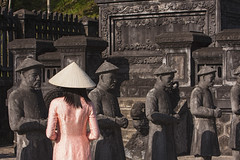 Hue, Ancient Capital of Vietnam (Sharpshooter Alex) Tags: female woman vietnam vietnamese travel asia aodai traditional clothing conical hat hue ancient capital statues