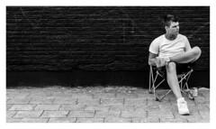 Watching... (LukeDaDuke) Tags: antwerp antwerpen belgium belgique belgie belgien belgica belgië street streetphotography streetlife urban urbanphotography urbanlife city citylife cityphotography bnw blackandwhite sit seat man person