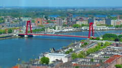 Willemsbrug and a view over Rotterdam (STEHOUWER AND RECIO) Tags: willemsbrug willemsbridge bridge brug rotterdam netherlands view aerial noordereiland nieuwemaas maas tiltshift tilt shift cityscape water boat boats shore buildings architecture gebouwen architectuur city stad holland dutch harbourcity cityview toy toys miniature miniatuur blue red green blauw rood groen white wit nederland zuidholland southholland transport trees bomen canon