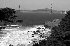Golden Gate Vista 11 Mono (TheseusPhoto) Tags: monochrome blackandwhite blancoynegro rocks water ocean bay nature naturephotography natureporn beautyinnature waves sanfrancisco california goldengate bridge trees