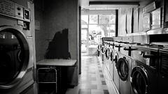 IMG_7104 (Kathi Huidobro) Tags: stylised urbanism southlondon unkempt vintage retro rundown london blackwhite bw monochrome urbandecay interiordesign interiors laundromat launderette