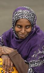 Division Street Portrait (eyepiphany) Tags: somalian blm blacklivesmatter somaliandress purpleandjaguarprintshawl tropicalorangebullseyeprint beautyonthestreet beautifulsmile ethnicfashion