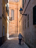 Seek the Light (Johnners61) Tags: menorca ciutadella spain europe holiday vacation street person old historic lamp medieval narrow city town balearics microfourthirds micro four thirds mft m4s olympuspen olympus pen ep5 church cathedral