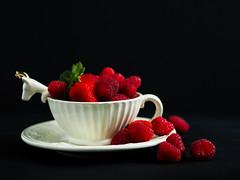 Raspberries & strawberries (Mery Weather) Tags: strawberries raspberries red tabletop stilllife lowlight