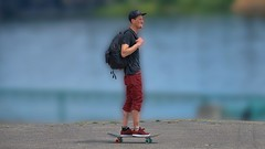 Skateboarding (Scott 97006) Tags: transportation man wheels skateboard guy riverside