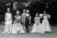 042168 14 (ndpa / s. lundeen, archivist) Tags: nick dewolf nickdewolf photographbynickdewolf 1968 1960s bw monochrome blackwhite blackandwhite 35mm film april neworleans louisiana lemlehouse lemlehome children girls younggirls dressup playingdressup dress dresses yard backyard onthegrass child girl younggirl nicole posing makingfaces