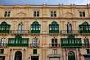 Malta Streets (Douguerreotype) Tags: balcony door glass symmetry malta green buildings window city architecture valletta urban sign