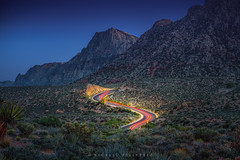 Red Rock Canyon light trails (Mike Filippoff) Tags: ngc redrockcanyon park nevada lasvegas sunset dusk lighttrails cactus mountains bluehour shrubs sky twilight car roadtwisty mountain landscape night clear nikonflickraward
