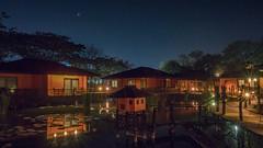 Good night Myanmar (cyangLtravel) Tags: landscape wooden houses water lake nightscape night stars trees orange lights lighting boat sunstars