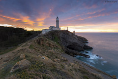 Lighthouse At Dusk. (dasanes77) Tags: canoneos6d canonef1635mmf4lisusm tripod landscape seascape cloudscape clouds dramaticsky colors mammatus orange blue bluehour longexposure sea cantabria santander lighthouse light sunset sun composition