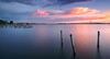 Three survivors. (Jill Bazeley) Tags: sunset sunrise causeway bridge dock pier jetty boat speedboat hurricane damage piling intracoastal waterway indian river lagoon brevard county florida space coast smooth reflection sony app a6300 1018mm