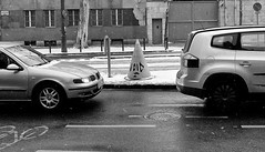Fill It (tcees) Tags: bartókbélaway budapest hungary buda snow snowing cars traffic tree windows door gate bollards pavement streetphotography street road urban bw mono monochrome blackandwhite nikon d5200 1855mm cone manholecover cctv drainpipe bars wall building cold freeze freezing