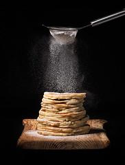 Pancakes (Grzegorz Kusyk) Tags: pancakes sugar milk egg flour butter black blackscreen wood dessert