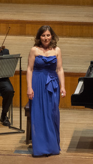 DSCN0712c Sofya Bugayan takes a bow after playing Tchaikovsky Piano Concerto No. 1. Assembly Hall, Worthing, UK. 13th May 2018