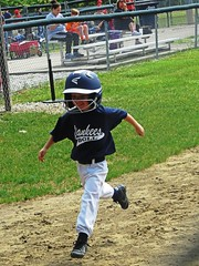 IMG_7328 (kennethkonica) Tags: kids children family face canonpowershot canon indianapolis indiana indy midwest usa america hoosier random xmas mood people person color eyes atmosphere beecggrovelittleleague running movement uniform helmet fence game yankees