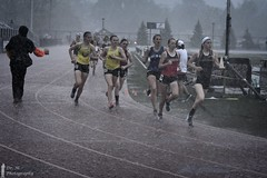 Monsoon Run (Dr. M.) Tags: rain trackandfield sport girls runners running deluge track wet pouring determination struggle