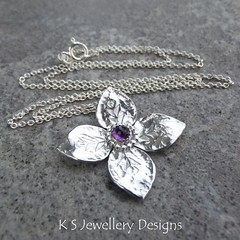 Amethyst Dappled Flower Sterling Silver Pendant (KSJewelleryDesigns) Tags: metalwork flower pendant necklace jewellery jewelry handmade brightsilver shine sterlingsilver silverjewellery handcrafted silver silverwire metal hammered shiny polished bright soldered soldering brushed flowers petals sawing piercing silversmith silversmithing daisy daisies blooms blossom gemstone cabochon flowerpendant swirlblossom texture stamens organic wirework stonesetting amethyst dappled amethystpendant