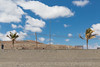 bench marks (Rasande Tyskar) Tags: fuerteventura islascanarias canaryislands kanarischeinseln tarajalejo beach strand playa sky himmel ciel clouds wolken sand minimal seawall prmenade bench benches palm tree palmen