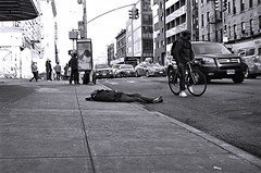 Delancey (sjnnyny) Tags: nikonf100 35mmfilm stevenj sjnnyny nyc streetphoto traffic homeless nylife gritty monocrome bw people journalistic