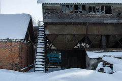 An old broken sorting complex in the winter. Destroyed factory (ivan_volchek) Tags: winter snow wood building outdoors house architecture cold abandoned old wall travel traveling visiting construction ice sky frozen broken industry window