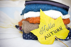 A pile of warm sweaters and a yellow maple leaf (yannamelissa) Tags: sweater warm pile folded winter wardrobe wool cozy stack white clothing table soft autumn lifestyle textile background woolen cloth garment knitted fashion cold style home design fall knitwear cashmere nobody life comfortable apparel fabric concept stacked pattern texture september october november moody mood hello cosiness bright yellow color colorful colour