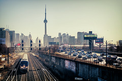 That Friday Morning Hustle (Paul Flynn (Toronto)) Tags: amtrak train track tracks highway road street traffic rush hour city toronto cntower cn tower rail exhibition skyline morning sun daylight