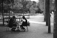 The chess players (•Nicolas•) Tags: analog bw film fp4 ilford m4p luxembourg paris france park nicolasthomas chess player outdoor jardin